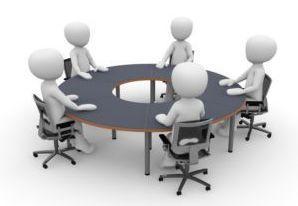 Grafika przedstawiająca grupę ludzików siedzącą przy stole